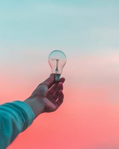 person person holding light bulb idea