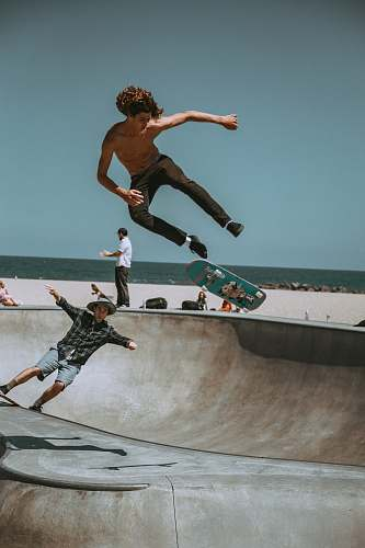 iphone wallpapers two men skateboarding on bowl ramp iphone backgrounds
