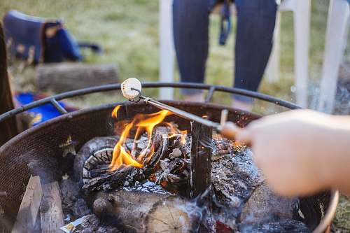 human macro shot of fire pit table food