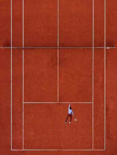 sport man lying on tennis field tennis court