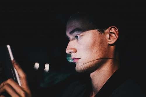 people man using phone during nighttime human