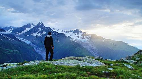 nature person standing in front of mountain landscape photography alps