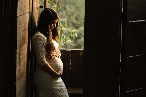 photo human pregnant woman holding her womb girl free for commercial use images