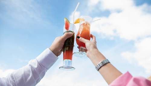 drink two person holding clear drinking glasses maldives