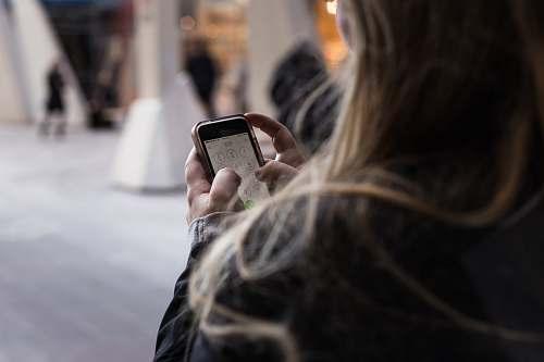 woman person unlocking smartphone female