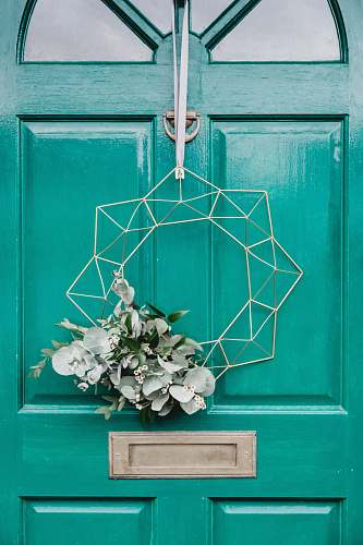 photo vase white hanging wreath on green door flora free for commercial use images