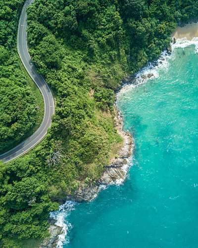 nature bird's eye photography of road near near body of water thailand