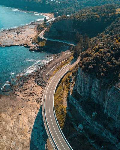 coast birds eye view of highway beside bay australia