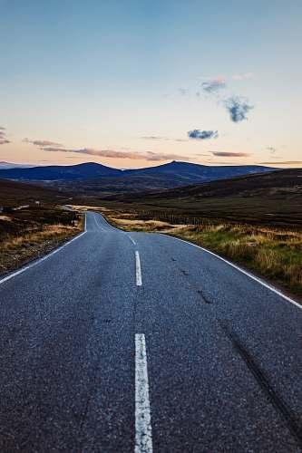 landscape empty road towards mountain scotland