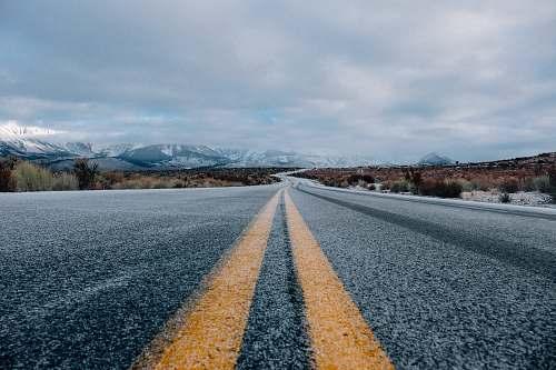 landscape landscape photography of asphalt road under cloudy sky during daytime nature