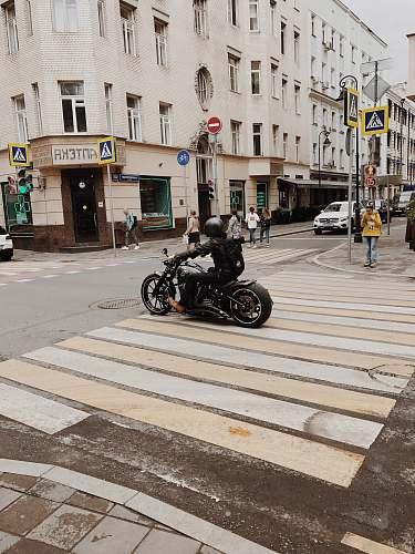 asphalt person rides motorcycle tarmac
