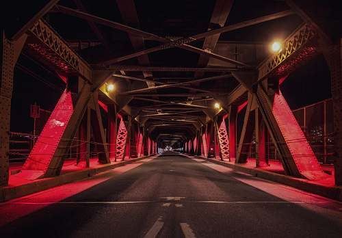 photo highway red and black metal bridge during nighttime freeway free for commercial use images