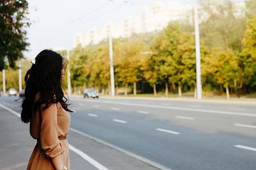 photo woman woman standing beside road looking out free for commercial use images