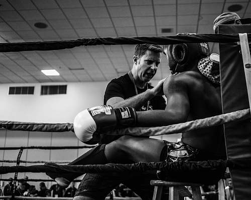 black-and-white greyscale photography of a boxer inside reing boxing