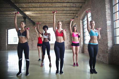 fitness group of women exercise using dumbbells people