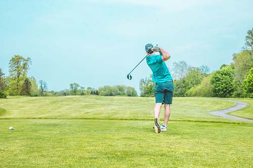 photo golf man playing gold under blue sky during daytime person free for commercial use images