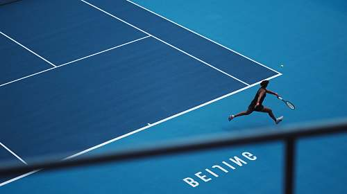 person man playing tennis in court human