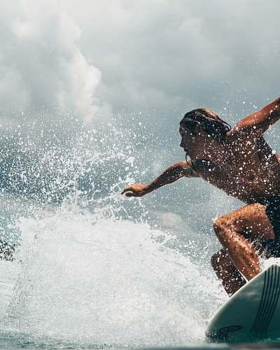 surfing man surfing surf