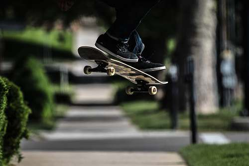 sports person riding on skateboard doing exhibition trick skateboard