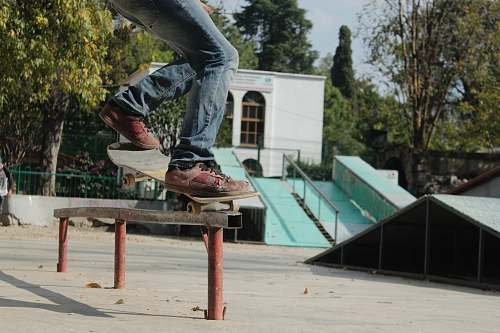 person person skating on rail during daytime skateboard