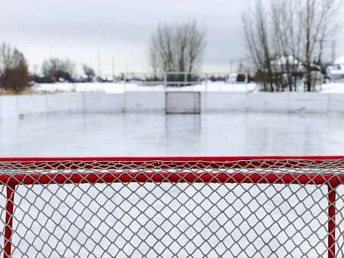 sports red and white goal net on ice field rink