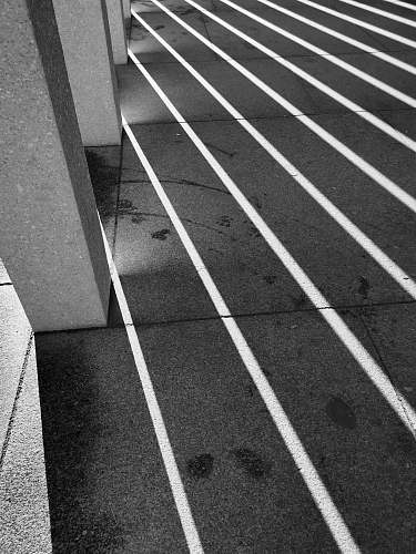 photo running track shadows casting on paved floor black-and-white free for commercial use images