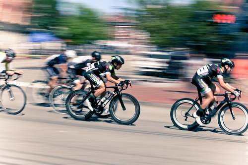 photo bicycle time lapse photography of bikers cyclist free for commercial use images