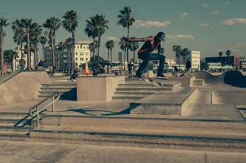 skateboard time lapse photography of man skateboarding outside urban