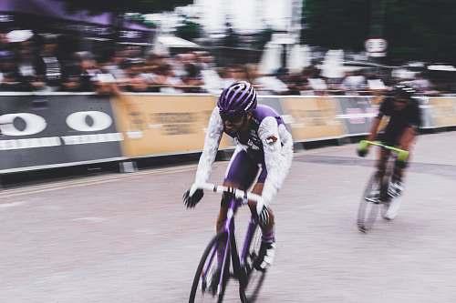 bicycle two men bike racing during daytime bike