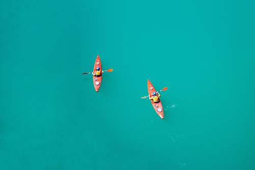 water two person kayaking on open body of water transportation