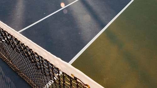 sports white and black tennis net tennis court