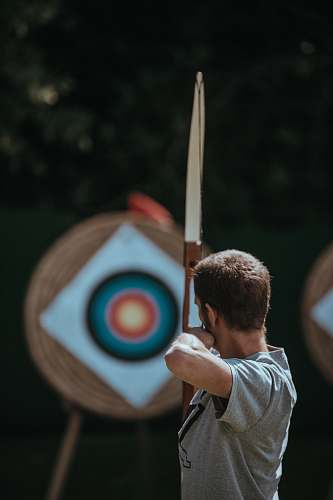 human white and brown composite bow archery