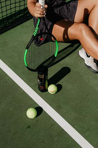 photo human woman sitting while holding tennis racket beside balls ball free for commercial use images