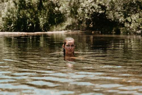 photo person woman swimming at river human free for commercial use images
