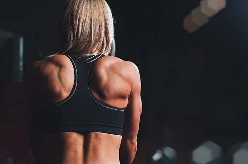 fitness woman wearing black sports bra facing front selective focus photography sports