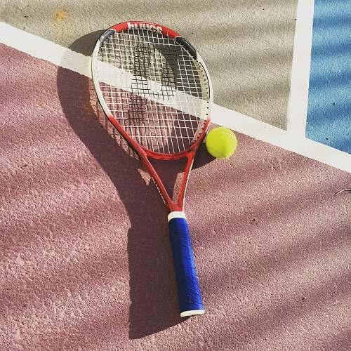 tennis yellow and white tennis racket racket