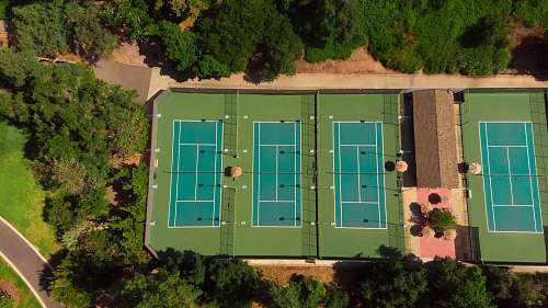 sport aerial photography of three tennis courts tennis court