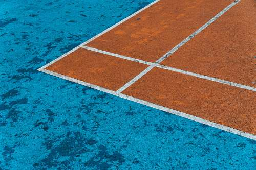 sport brown and blue surface close-up photography tennis court