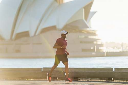 photo working out man running near Sydney Opera House exercise free for commercial use images