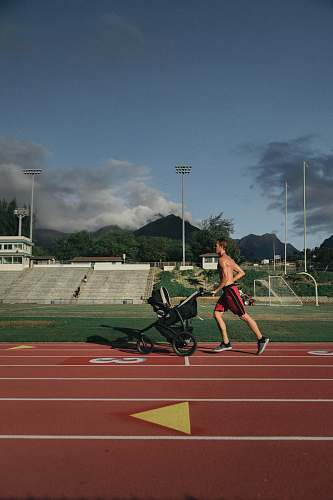 photo human man running while holding stroller person free for commercial use images