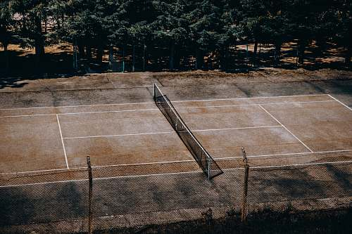 sport tennis court near trees tennis court