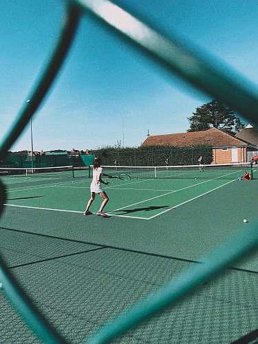 human woman playing tennis on court tennis court