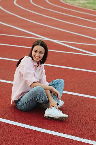 photo human woman sitting on track running track free for commercial use images