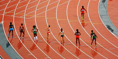 sport women running on race track during daytime running