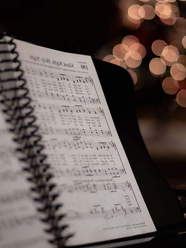 photo book opened musical book at Silent Night, Holy Night page diary free for commercial use images