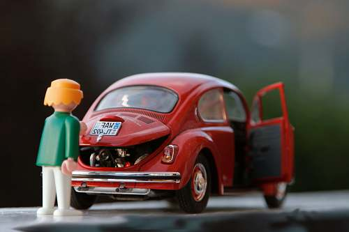photo car orange hair Lego toy looking at red beetle car toys free for commercial use images