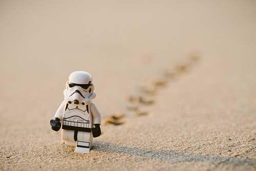 lego Stormtrooper minifigure walking on the sand human