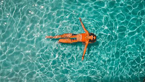 photo swimming woman swimming alone in body of water sport free for commercial use images