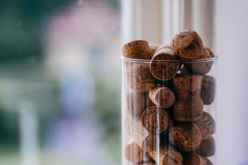 photo nut brown cork lot on glass container food free for commercial use images