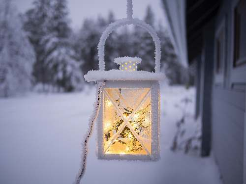 photo sodankylä white pendant lamp hanging on ceiling outside of snow covered forest finland free for commercial use images